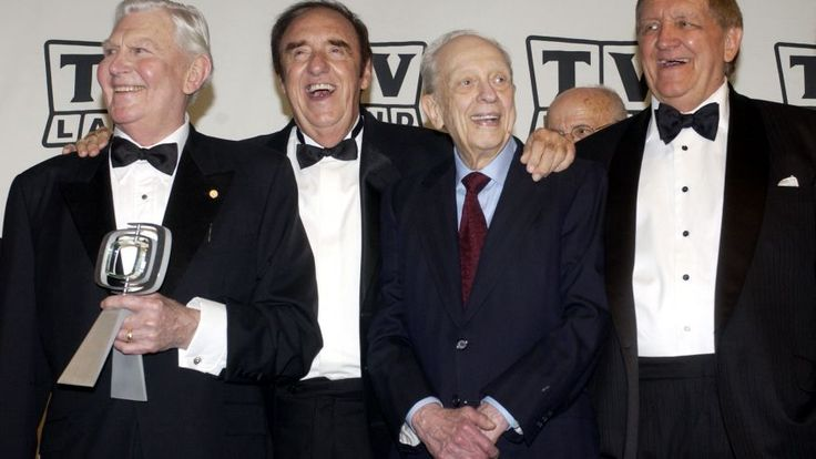 """Andy Griffith, Jim Nabors, Don Knotts and George Lindsey, cast members in """"The Andy Griffith Show,"""" pose backstage after accepting the Legend Award for their series during a taping of the second annual TV Land Awards in Hollywood March 7, 2004. (Reuters)"""