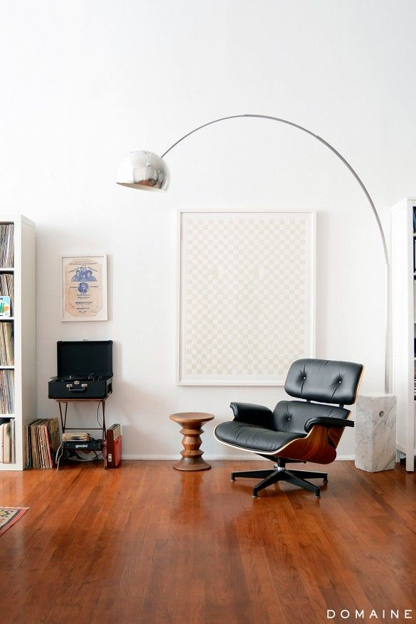 Living room corner with Eames lounge chair and FLOS Arco floor lamp.