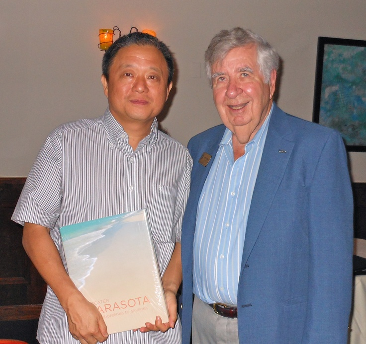 "Xiamen Art Professor Qin Jian and SSCA President Tom Halbert at a reception for the practicing artist and Chair of the Multimedia Department of Xiamen University College of Art, at Libby's during his exchange visit to Sarasota in August 2011.  Prof. Qin Jian curated ""Hanging in Balance: Ten Emerging Chinese Artists"" art exhibition that was displayed Aug. 12-17, 2011 at the Selby Gallery of Ringling College of Art and Design."