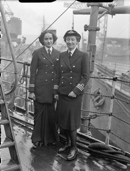WRINS (WRENS from India!) on study visit to UK bases, June 1945 - Chief Officer Margaret L Cooper, Deputy Director of the Women's Royal Indian Naval Service (WRINS), with Second Officer Kalyani Sen, at Rosyth during their two-month study visit to Britain. [Wonderful draped uniform skirt that Officer Sen is wearing!] in the Imperial War Museum.