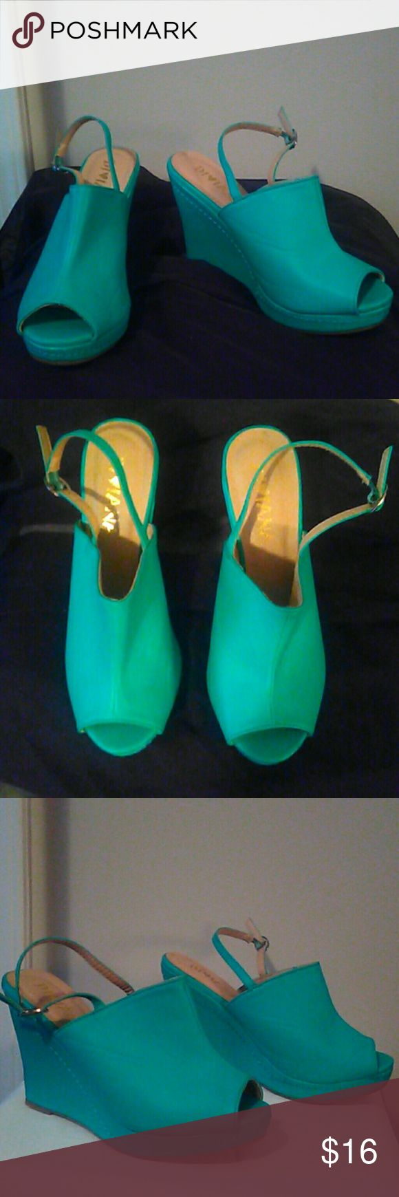 Teal wedges! Teal wedges in excellent condition. Brand new. Never worn. No box diviana Shoes Wedges