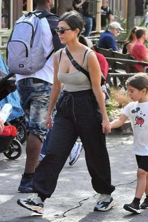218f69e94242d Kourtney Kardashian wearing Adidas Yeezy 700 Wave Runner Sneakers