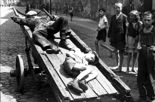 Warsaw, Poland, Two children sleeping on a cart in the ghetto, 1941. One of the photographs taken by the German photographer Willi George over the course of a single day in the summer of 1941. The photographs are unique in that they were not staged, but showed the ghetto as it truly was.