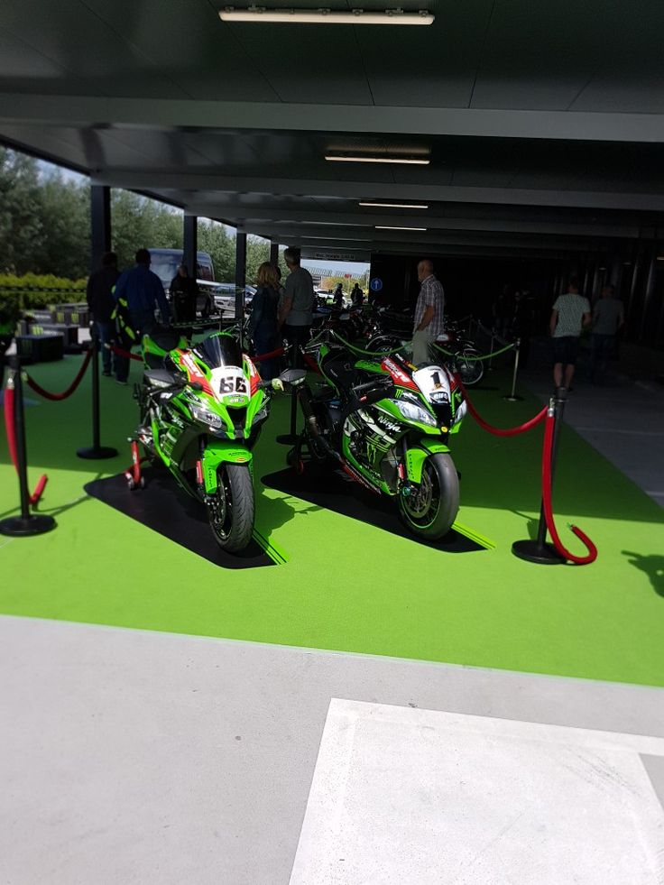 My boyfriend his replica bike of #66 tom sykes next to the real #1 jonathan rea 💚💚💚