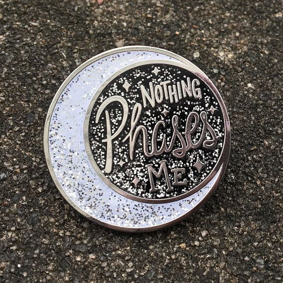 The world needs more chill. This hand-lettered pin is a celestial reminder to relax and breathe deep in times of stress. -1.25 diameter (32mm) -Hard enamel, black and white glitter -Polished nickle (silver) metal -Black rubber pin back -Illustrated card packaging -Designed & illustrated by Felice Regina