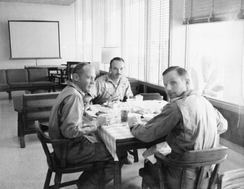 July 30, 1969 – Days after returning from their historic mission to the Moon, the crew of Apollo 11 remains in quarantine. Left to right, astronauts Buzz Aldrin, Michael Collins, and Neil Armstrong dine in the Crew Reception Area of the Lunar...