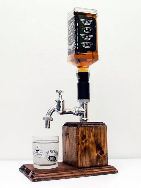 Handmade Wooden Liquor Dispenser, Whiskey Dispenser, Alcohol Dispenser, alcohol gift, liquor gift, whiskey gift Hand made chrome fittings alcohol dispenser. The chrome fittings are attached on to a large solid block of wood. The wood is hand stained and painted with pure tung oil for an alcohol resistant finish. Our system is easy to use, just turn the dispenser upside down insert an open alcohol bottle, turn it upright and youre done. No fittings need to be inserted and no holes need to…