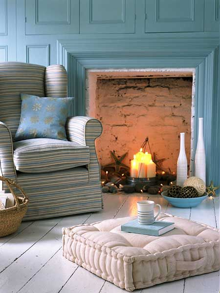 """""""Even when it is too warm for a blazing fire, you can use your fireplace to create atmosphere by adding candles or even white sting lights. For an extra touch, lean a mirror against the back wall to add extra dimension. (Photo: IPC Images)"""""""