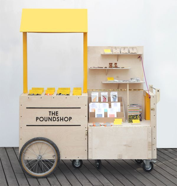 This small, single seller, mobile booth is super cute! It's the one man band style pop-up shop. It's great that it's on wheels, makes for a quick easy clean up.