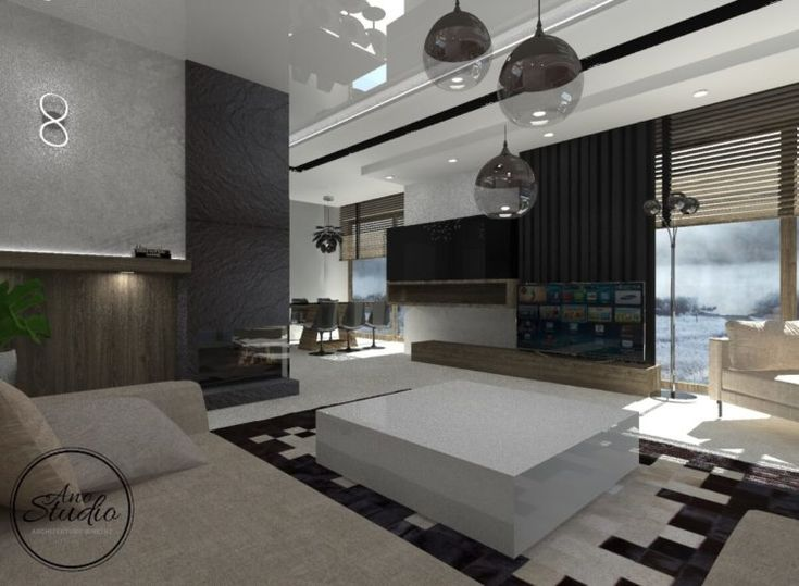 Salon z jadalnią Materiały wazastosowane w projekcie: Na ścianach tynk dekoracyjny imitujący beton Na kominku czarny granit Sufit w połysku - sufit napinany