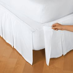 fitted sheet on box spring and then attach skirt with velcro.