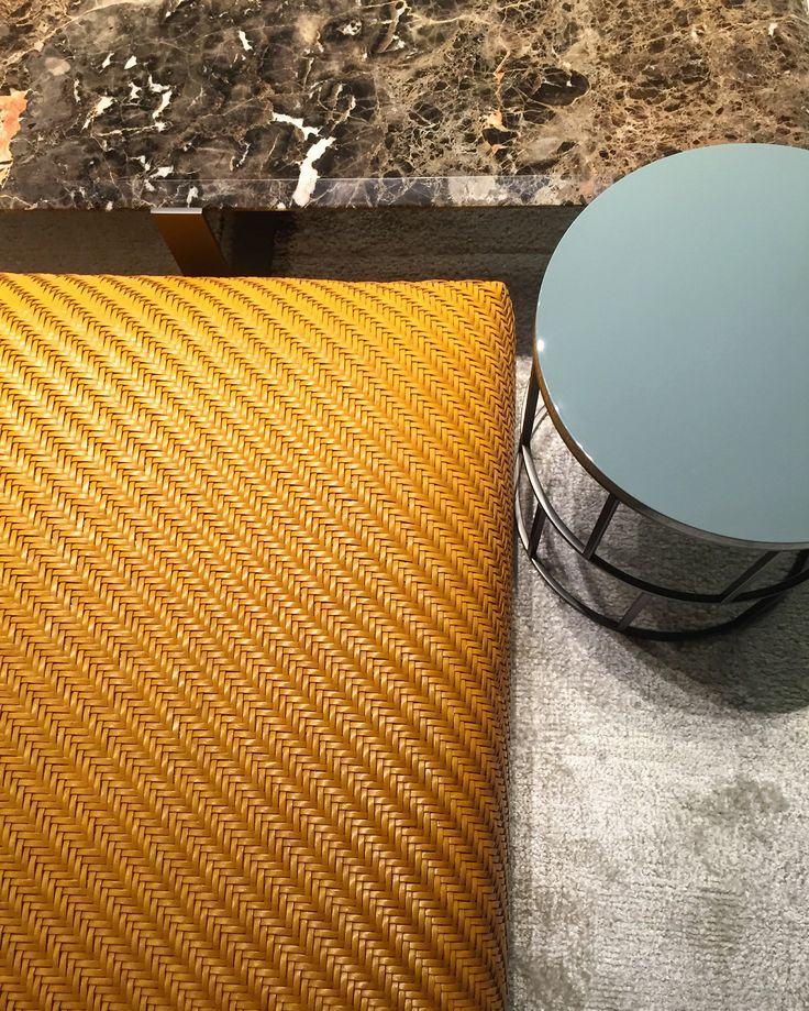 Glossy mint and sage on the side table sits next to astonishing mustard colour leather and rich marble. #mood #mint #sage #glossy #mustard #leather #textures #colours