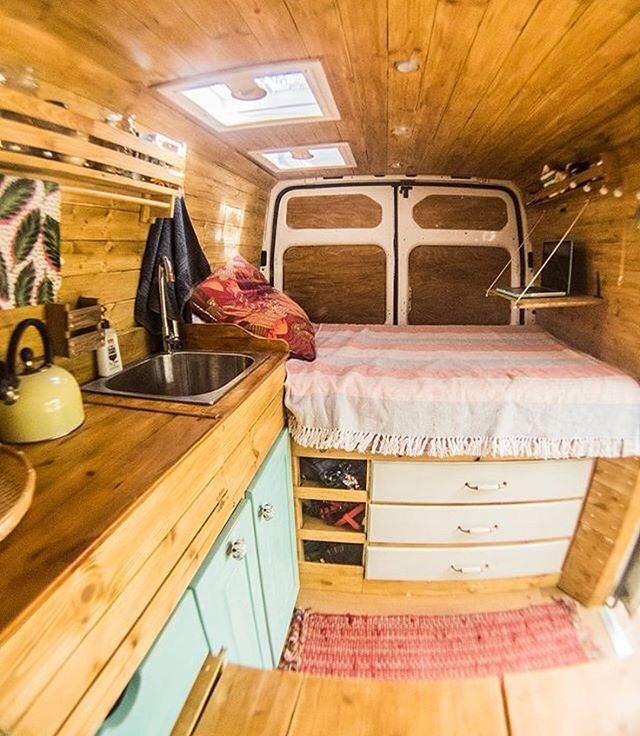 """Photo by @veggievanlife #vanlifers #vanlife #vanlifeproject —""""Keeping our van this tidy is near impossible! For this reason we've got multiple """"junk"""" areas. Underneath the bed and above the cab prove useful for accommodating things that we don't necessarily need all of the time!"""""""