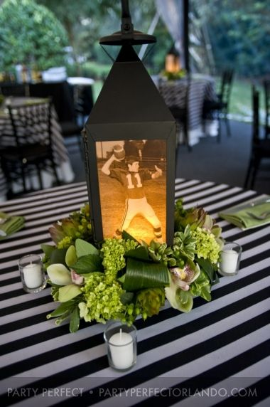 Personalized table lanterns work double duty: give softer lighting and emphasize your theme!