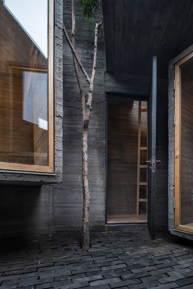 Micro hostel with tiny concrete rooms installed by Zhang Ke in old Beijing hutong