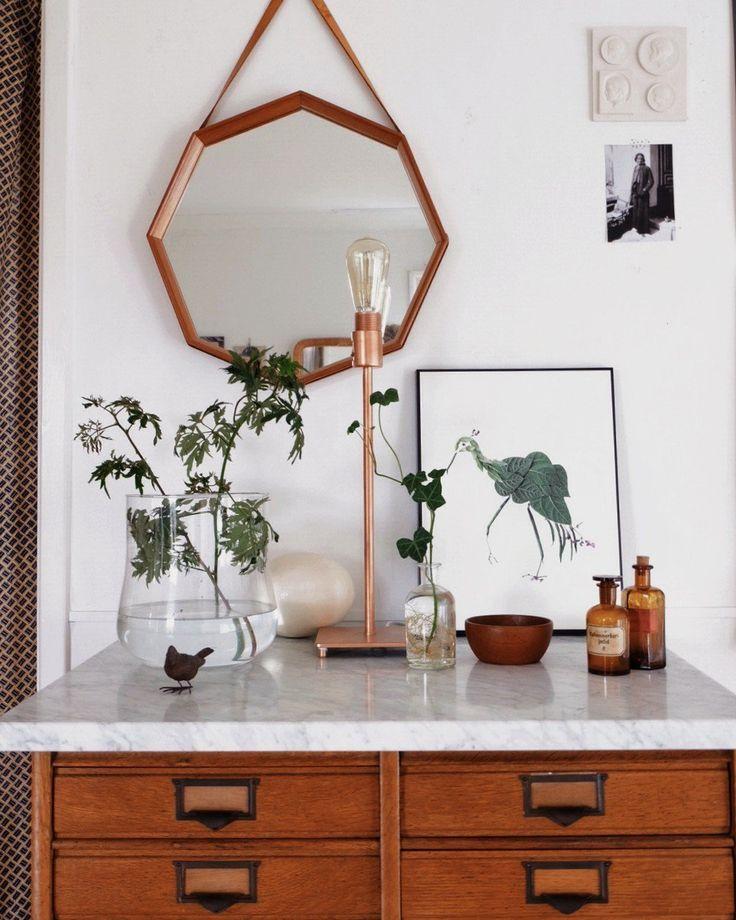 This dresser vignette walks such a nice line between feminine and masculine decor styles.