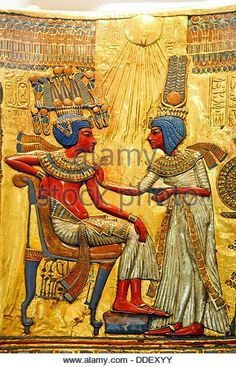 The queen ankhesenamen anointing her husband Tutankhamen beneath the life-giving rays of the sun