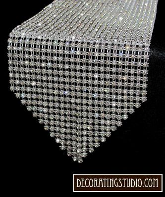 Rhinestone table runner.  Wouldn't this look great on the cake table!! Add some bling.