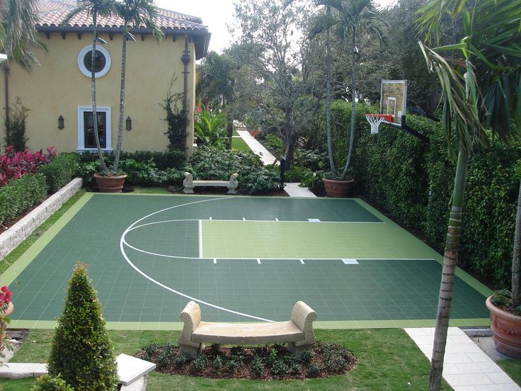 Check out this two tone green basketball half court great for Backyard sport court ideas