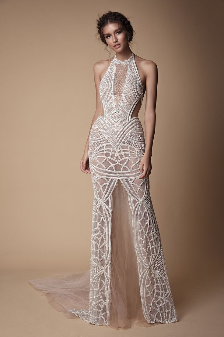 High necked sleeveless wedding gown with sheer middle slit and side panels // You've seen the sexy yet sweet Muse by Berta 2018 wedding dress collection, now here's Berta's Fall/Winter 2018 evening line of ball gown, fit and flare, and form fitting silhouettes, in case you're looking to slip into something different for your reception.