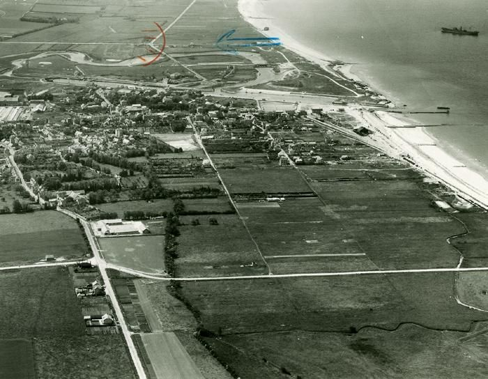 """Courseulles sur Mer - The western end of the Canadian 3rd Infantry Division D-day assault beach east of the breakwater was codenamed """"Nan-Green beach"""", attacked by the Regina Rifles Regiment. Note the concrete blockhouse on the shoulder of the coast road is still present as are several more in the dunes west of the breakwater."""