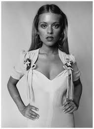 Ossie Clark fashion, 1970 Edina Ronay models a dress by Ossie Clark with sweeheart neckline, fake flowers and ruched sleeves