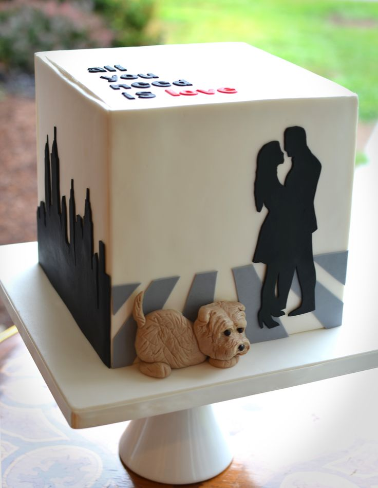 - Engagement cake with NYC skyline, the couple's silhouette and their little dog.