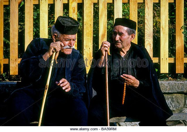 Greek men wearing traditional costume in the mountain town of Metsovo in the Epirus region in the Pindos Mountains - Stock Photo