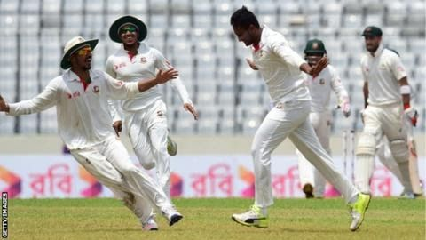 Shakib Al Hasan (centre) ended the match with 10 wickets  First Test Dhaka day four  Bangladesh 260 & 221: Tamim 78 Mushfiqur 41; Lyon 6-82  Australia: 217 & 244: Warner 112; Shakib 5-85  Bangladesh win by 20 runs  Scorecard  Bangladesh  secured an historic first Test victory over Australia in Dhaka with  Shakib Al Hasan finishing an engrossing match with 10 wickets.  Chasing  265 for victory Steve Smith's Australia looked set to win on the  penultimate day of the first Test after David…