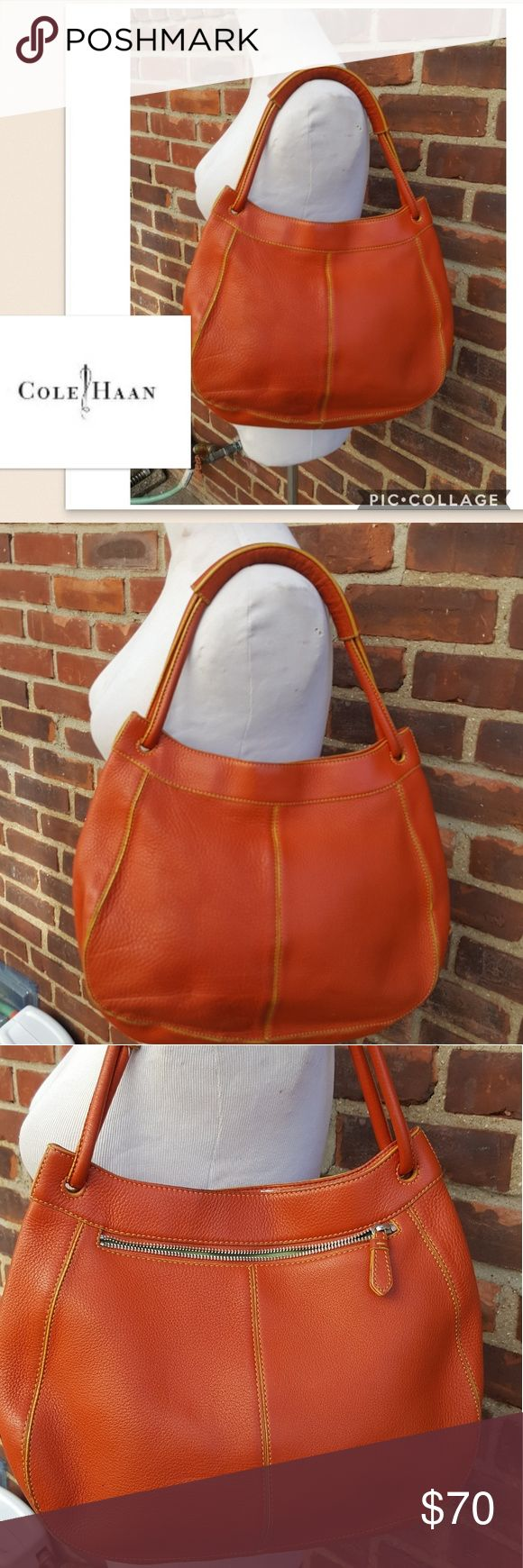 Cole Haan pebbled leather shoulder bag Nice orange bag in very good condition with one tiny almost imperceptible Inkspot. Super clean inside and has just been cleaned and conditioned. No dust bag. Height is a little hard to measure because of the shape of the bag. Cole Haan Bags Shoulder Bags