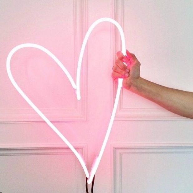 Brighten up your room with a pink neon light.