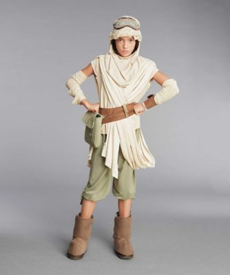Ultimate Rey™ Kids Costume - exclusively ours - Step into the role of independent, self-reliant Rey™ in Star Wars: The Force Awakens. Dress in gear that protects from the sand and allows for agile scavenging. You'll blend into the surroundings in a tan tunic and pants, plus a matching hood, mask, glovelets, wristband and bootcovers. Keep supplies close at hand in the belt pouch (you never know what -- or who -- you'll run into on the planet Jakku). Polyester. Imported. © & ™ Lucasfilm Ltd.