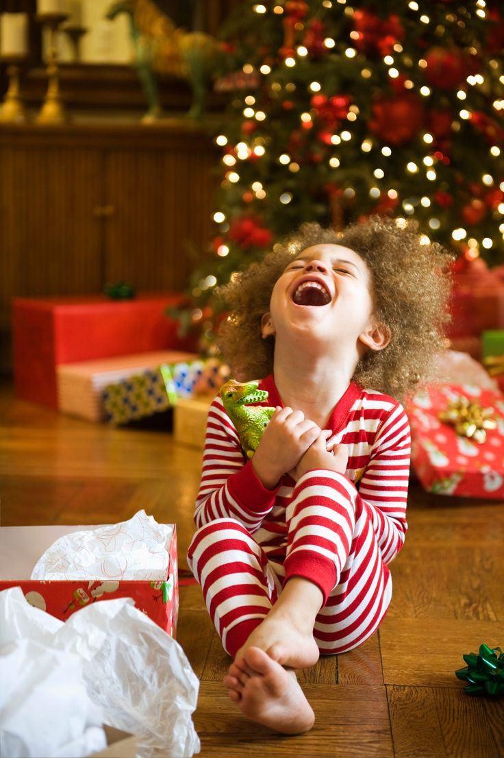 Excited mixed race boy opening Christmas gift - Excited mixed race boy opening Christmas gift