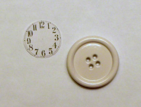 Tiny clock out of a watch, printed clock numbers and a button.