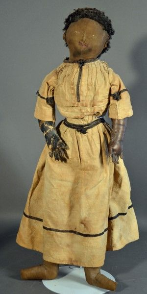 """22"""" black cloth doll, center seam on face, embroidered features, caricul wig, (worn at back), cloth body w/black leather arms, (worn), antique clothes..."""