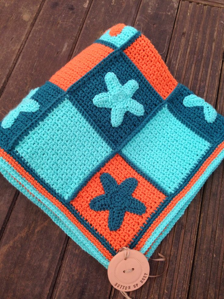 Star blanket in shades of orange and teal by Button up Baby