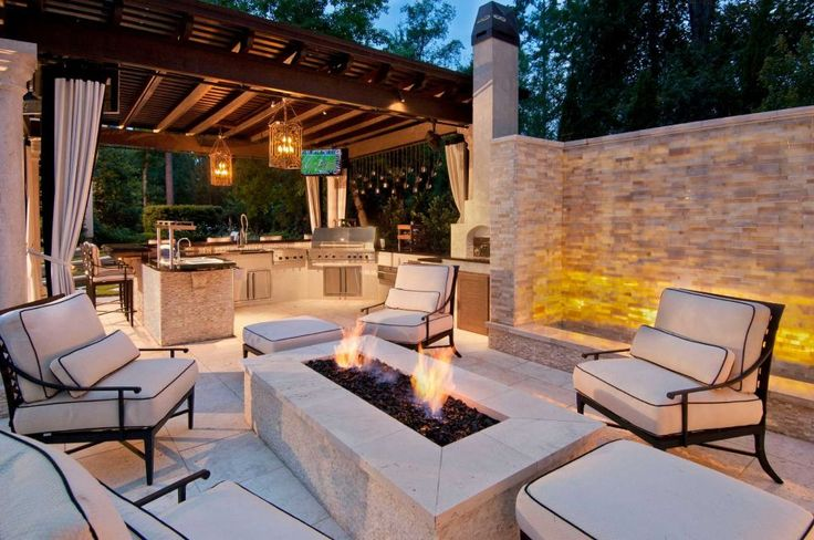 This home in The Woodlands features a rectangular fire pit.
