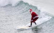 Santa surfs in North Myrtle Beach after the Christmas Holiday.