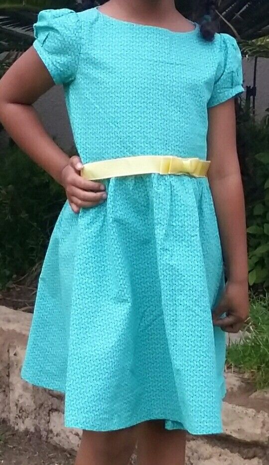 Girls dress using shweshwe print. Burda kids 9545
