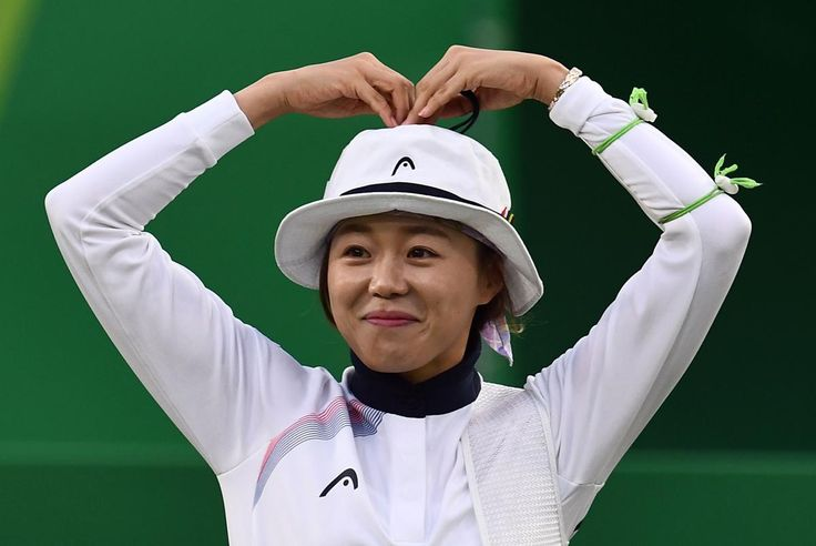 South Korea's Hyejin Chang celebrates after defeating Germanys Lisa Unruh during the women's gold medal match at the Sambodromo archery venue