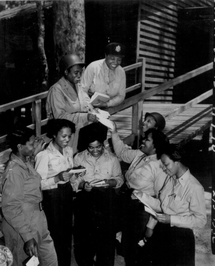 African-American US Army nurses receiving mail from home, 268th Station Hospital, Australia, 29 Nov 1943; 3 of the nurses were Lts. Prudence L. Burns, Inez Holmes, and Birdie E. Brown. (US National Archives)