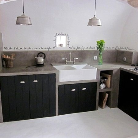 Love the concrete! Rather halve drawers instead of doors though..