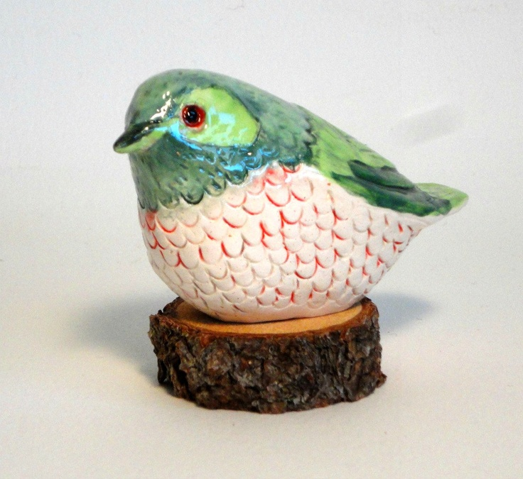 clay bird sculpture. I like the texture of the underpart of the bird and the color combinations.