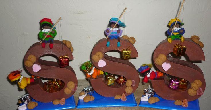 Letters ( Xenos ) een likje bruine verf gegeven . Pakjes , pepernoten en snoepgoed erop . En tot slot Pietjes ( Pa...