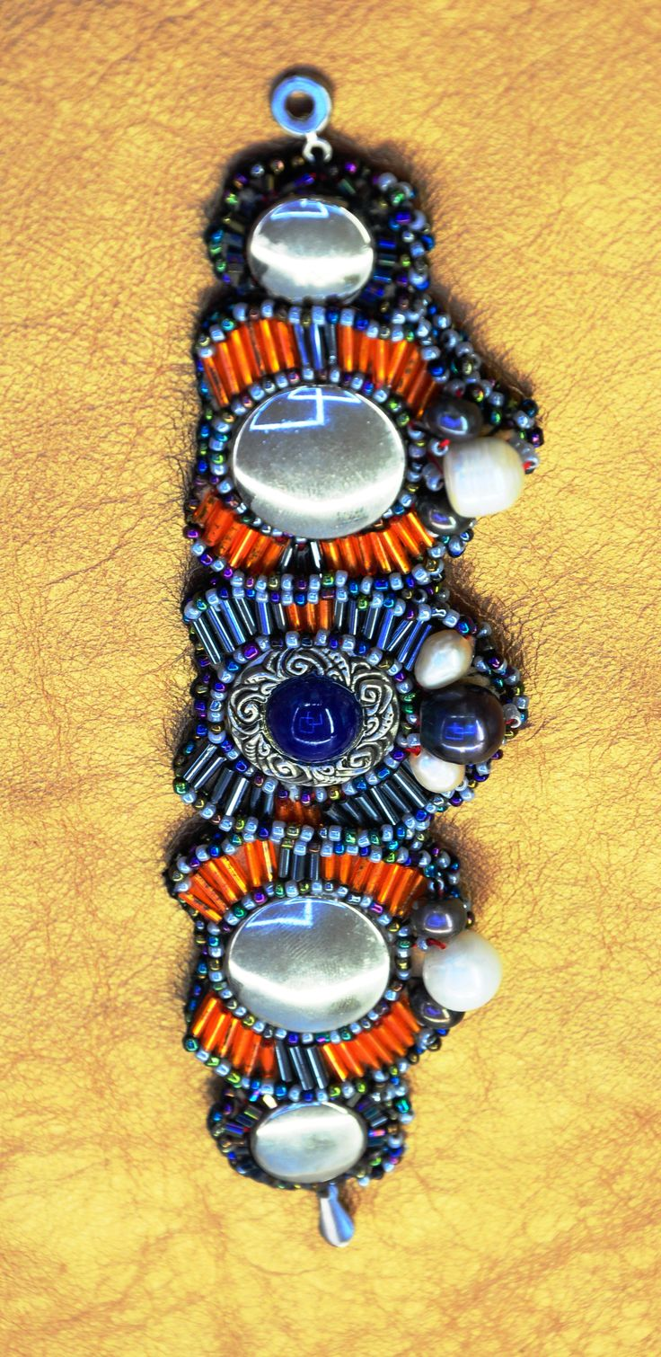 Hand made Couture Bracelet Natural sea pearls, Vintage buttons, Tubular beads and genuine elephant leather inside