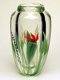 """This beautiful style of crystal encased glasswork leads many first time viewers to ask about the flowers that have been """"painted"""" inside the vase. Of course, the Cala Lily, the Bird of paradise, and the delicate blue mountain lupine are all made of glass, an integral part of the vase, and the illusion that they were painted after the fact is a wonderful testament to the quality of Scott Beyers design and his skill as a glassworker."""
