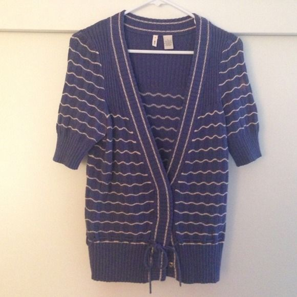 Anthropologie nautical cardigan Blue and white knitted cardigan with detailing throughout. Open bust with snap closures and drawstring at bottom. Fitted band at sleeve, creating a full upper arm effect. Slight discoloration on left underarm, price reflects such. By Moth, purchased at Anthropologie. Anthropologie Sweaters Cardigans