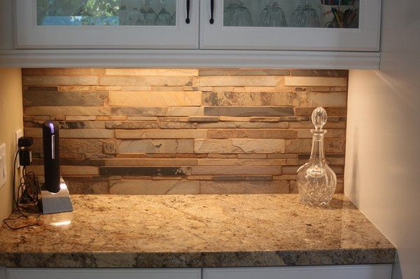 granite counters with stacked stone backsplash cabin