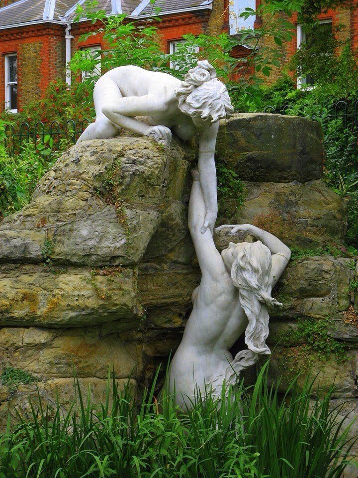 Amazing sculpture art!  These appear to be made for the rock garden/fountain they play on.  Very cool, wot?