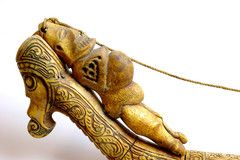 Ancestor sleeping on the back of the dragon.  The ancestor is made of fish bone, the dragon is in buffalo bone. The object is a gun powder container, dating back the first decades of XXth century. Terrific!